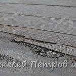 Уложенная в декабре в лужи плитка в Горловке начала проваливаться
